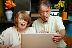 Senior couple shocked at the content on their comp Stock Photography