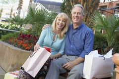 Senior Couple With Shopping Bags Royalty Free Stock Image