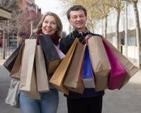 Senior couple with shopping bags outdoors Stock Photos