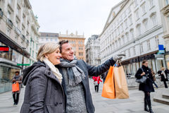 Senior couple shopping in centre of the city. Winter Stock Image