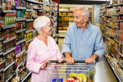 Senior couple shopping in grocery store Stock Image