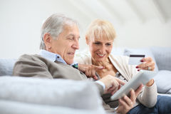 Senior couple shopping on internet Stock Photography
