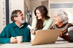 Senior couple shopping online Stock Images