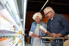 Senior Couple Shopping in Supermarket stock images