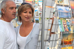 Senior couple shopping during vacation Stock Photos