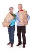 Senior couple shopping vegetables Stock Photo