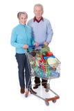 Senior couple shopping vegetables Royalty Free Stock Image