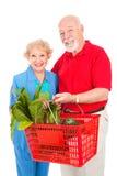 Senior Couple Shops Healthy Stock Photography