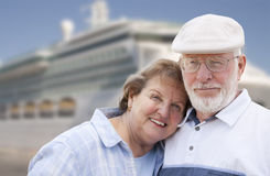 Senior Couple On Shore in Front of Cruise Ship Stock Photo