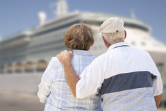 Senior Couple On Shore Looking at Cruise Ship Stock Photos