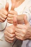 Senior couple show big finger Stock Images