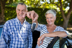 Senior couple showing car keys Stock Images