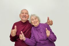 Senior couple showing ok thumbs up isolated on white background Royalty Free Stock Photos