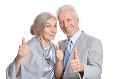 Senior couple showing thumbs up Stock Images