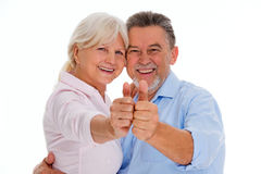 Senior couple showing thumbs up Royalty Free Stock Photos