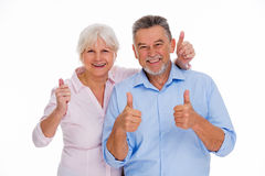 Senior couple showing thumbs up Stock Photography