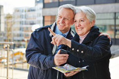 Senior couple on sightseeing tour Stock Photos