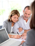 Senior couple signing contract royalty free stock photography
