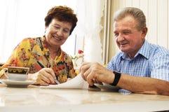 Senior couple signing document Stock Photo