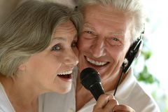 Senior couple singing karaoke. Close up portrait of happy senior couple singing karaoke Royalty Free Stock Photo