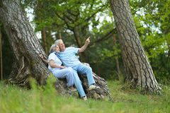Senior couple sit Stock Photography