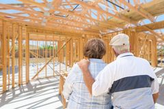 Sweet Senior Couple On Site Inside Their New Home Construction Framing Stock Image