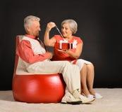 Senior couple sitting Royalty Free Stock Photo