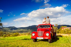 Senior couple sitting in back of red pickup truck Royalty Free Stock Photography