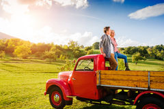 Senior couple sitting in back of red pickup truck Royalty Free Stock Image