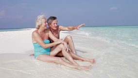 Senior Couple Sitting On Beautiful Beach stock video footage