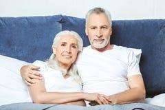 Senior couple sitting on the bed stock image
