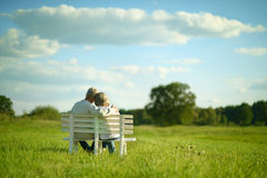 Senior couple sitting on bench Royalty Free Stock Image