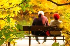 Senior couple sitting on bench royalty free stock images