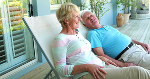 Senior couple sitting on deck chairs stock video
