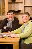 Senior couple sitting in dining room Stock Image