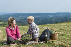 Senior couple sitting in the field Stock Photo