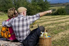 Senior couple sitting in the field Royalty Free Stock Photography