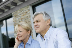 Senior couple sitting in front of the house Royalty Free Stock Photography
