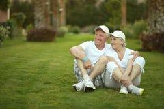Senior couple sitting on grass Stock Photography