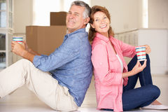Senior couple sitting in new home Royalty Free Stock Photos