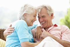 Senior Couple Sitting On Outdoor Seat Together Stock Photography