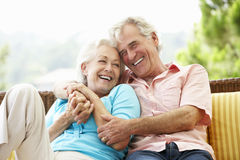 Senior Couple Sitting On Outdoor Seat Together Royalty Free Stock Photos