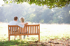 Senior couple sitting outdoors Royalty Free Stock Images
