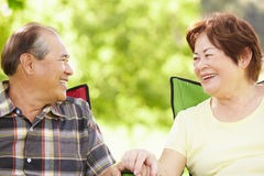 Senior couple sitting outdoors Stock Images