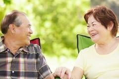 Senior couple sitting outdoors Royalty Free Stock Image