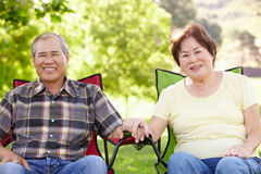 Senior couple sitting outdoors Stock Image