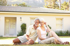 Senior Couple sitting Outside Dream Home royalty free stock photos