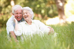 Senior Couple Sitting In Park Royalty Free Stock Photos