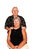 Senior couple sitting for portrait. Stock Images