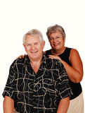Senior couple sitting for portrait. Stock Photos